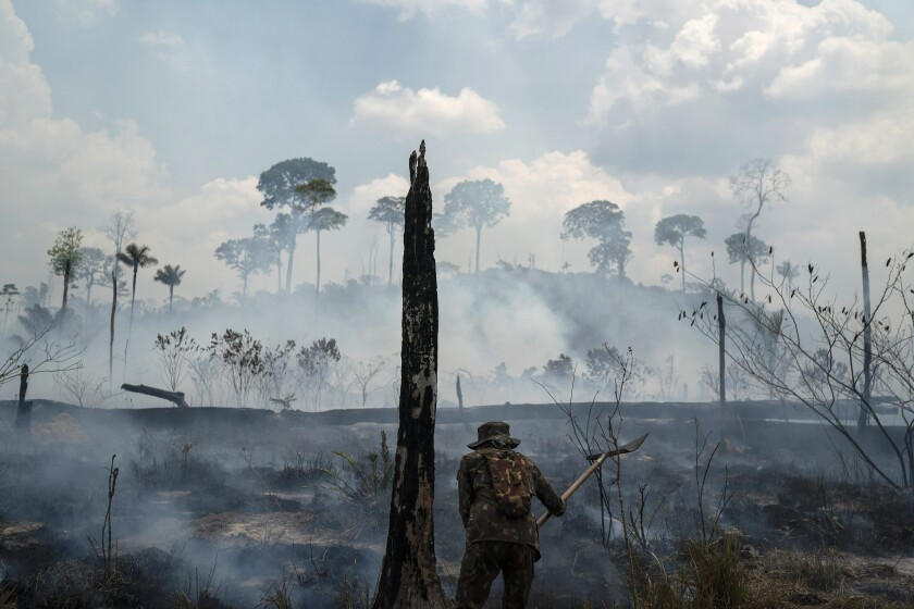 Brazilian soldier puts out fires in Amazon rainforest in September 2019
