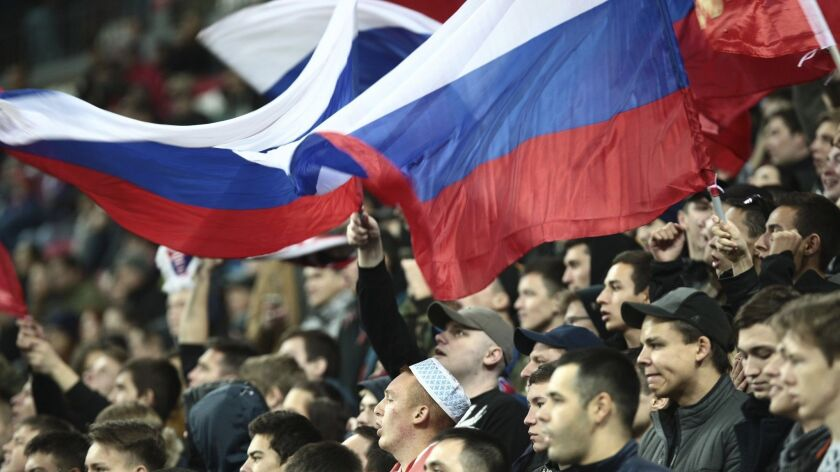 In this photo taken on Monday, May 7, 2018, Russian football fans react during the Russian premier l