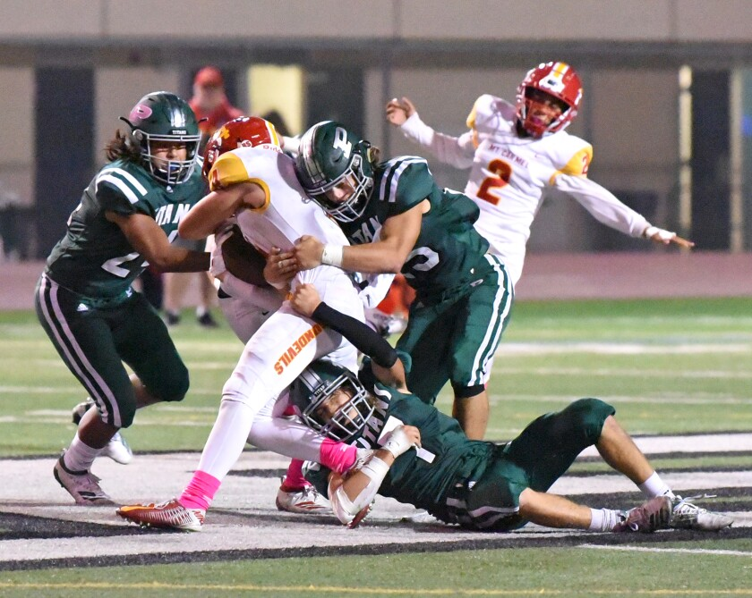 The Poway High Titans are preparing to face the Mt. Carmel Sundevils on March 19 in a delayed football season.