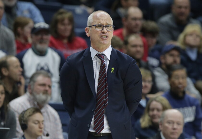 FILE - In this March 3, 2019, file photo, Connecticut coach Dan Hurley shouts from the bench during the second half of the team's NCAA college basketball game against South Florida in Storrs, Conn. Hurley said on Thursday, Nov. 12, 2020, that he is considering delaying the start of his team's season after a player's positive coronavirus test the week before that forced the program to suspend all activities for two weeks. (AP Photo/Steven Senne, File)