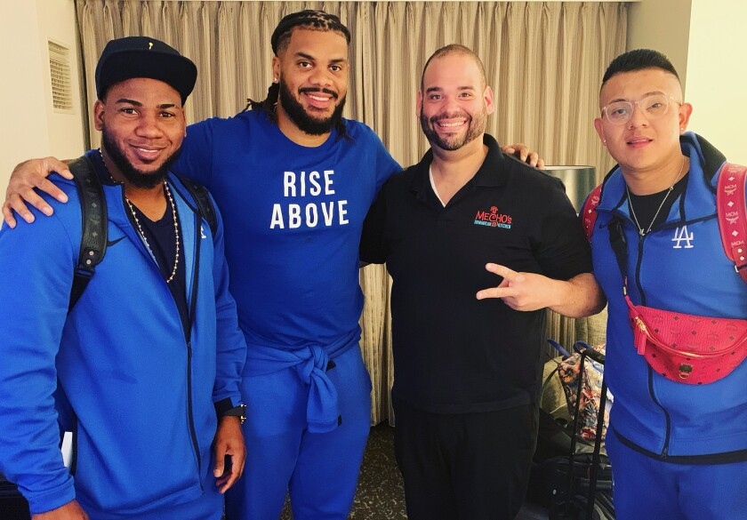Los Hermanos co-owner Aris Compres, second from right, with, from left, the Dodgers' Pedro Baez, Kenley Jansen and Julio Urias.