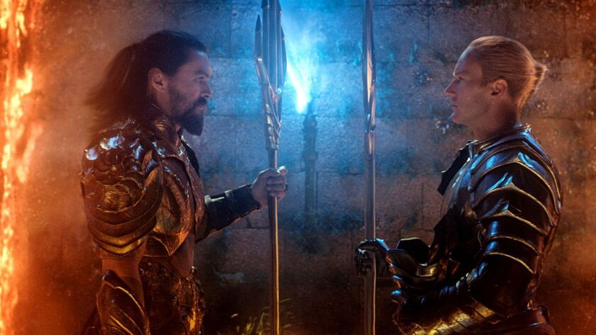 This image released by Warner Bros. Pictures shows Jason Momoa, left, and Patrick Wilson in a scene