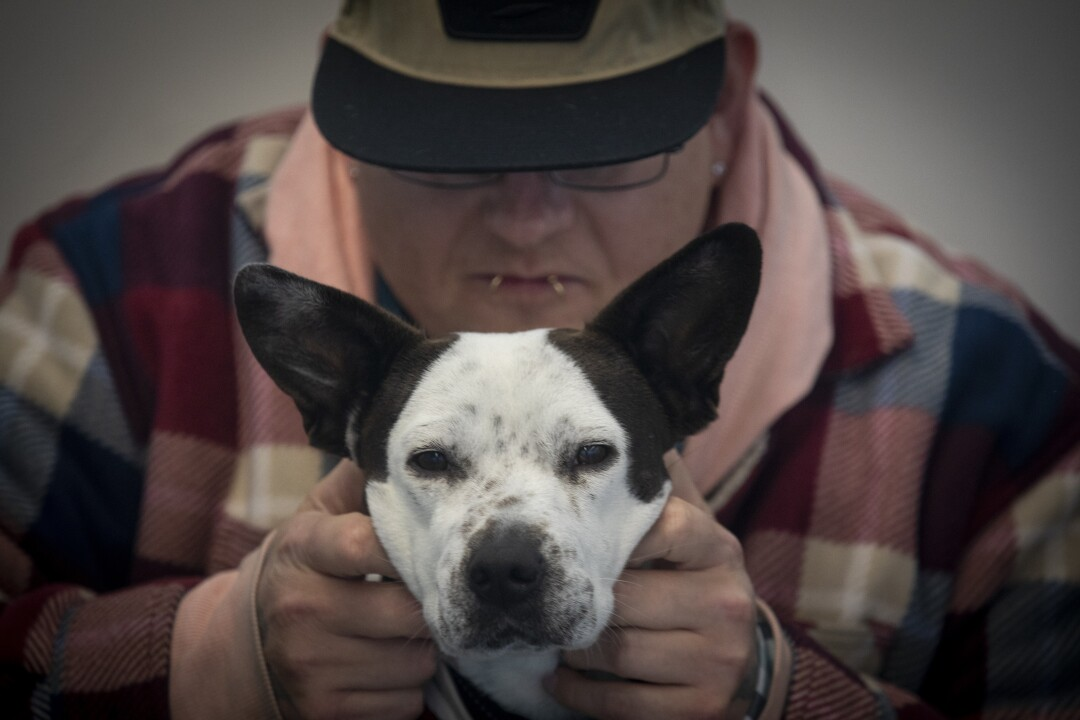 """I have to find a way to pay for her food,"" Seth Davis said of his support dog, Poppy."