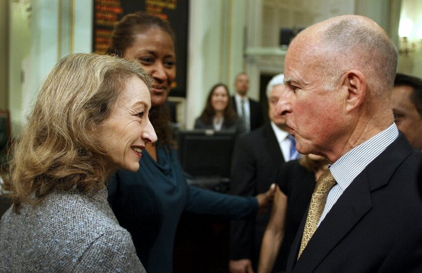 """Secretary of State Debra Bowen speaks with Gov. Jerry Brown after his State of the State address in 2012. Bowen told The Times on Friday that she has been sporadically absent from her office because of a """"debilitating"""" depression."""