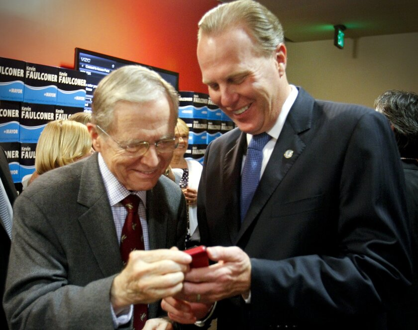 Former California Governor Pete Wilson & San Diego mayoral candidate Kevin Faulconer look at a smart phone during an election night party near the U.S. Grant Hotel, where supporters gathered in anticipation of his appearance.