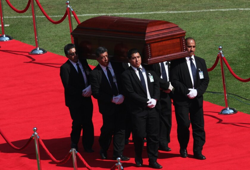 "The casket holding the body of Mexican comedian Roberto Gomez Bolanos is carried for a memorial service at the Azteca stadium in Mexico City, Sunday, Nov. 30, 2014. The iconic Mexican comedian who also wrote and played the boy television character ""El Chavo del Ocho"" defined a generation for millions of Latin American children, died Friday at age 85. (AP Photo/Marco Ugarte)"