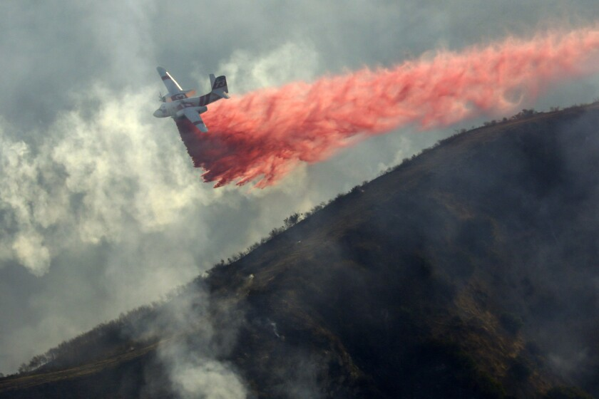 An airplane drops retardant on the Canyon 2 fire.
