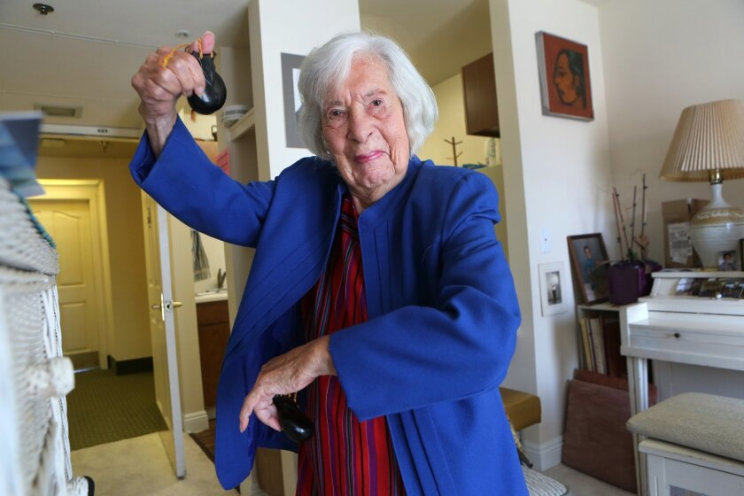 Amparo Ketcham, who turns 104 today, plays castanets in her San Marcos apartment while mimicking a Spanish dance she performed as a young woman. Bill Wechter Below: Ketcham in the 1940s.