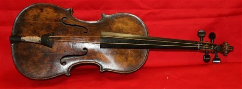 In this undated photo provided by Henry Aldridge on Friday, March 15, 2013 shows the violin that was played by the bandmaster of the Titanic as the oceanliner sank, Devizes, England. Survivors of the Titanic have said they remember the band, led by Wallace Hartley, playing on deck even as passenger