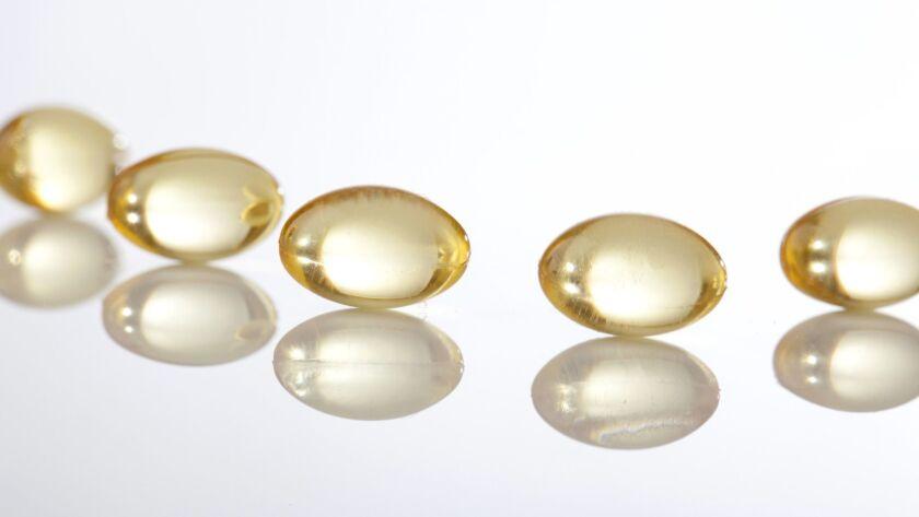 Vitamin D capsules (Jon Larson/Photodisc/via Getty Images)