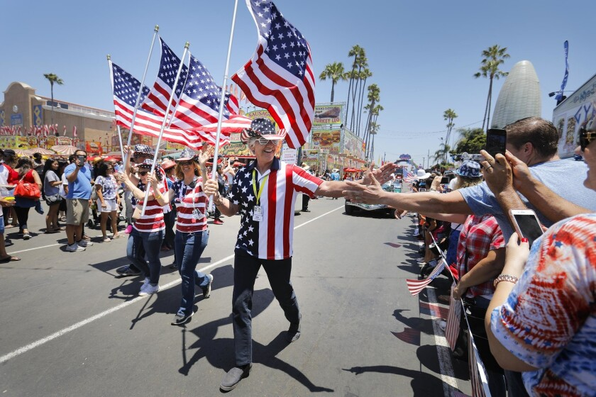 DEL MAR, CA 7/4/2018: The 4th of July Hometown Heroes Parade makes its way along the midway on the f
