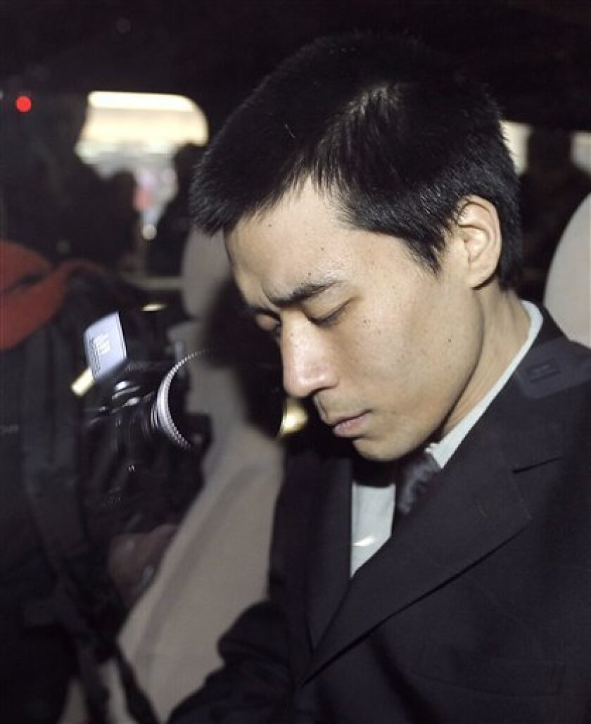 American missionary Robert Park is seen inside a vehicle after arriving at the Beijing Capital Airport, Saturday, Feb. 6, 2010. His arrival in Beijing came a day after North Korea announced it would free Robert Park. (AP Photo/Andy Wong)
