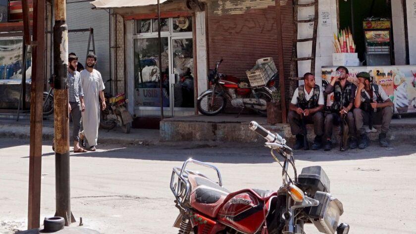 Traffic police take a break from work in Afrin city center.