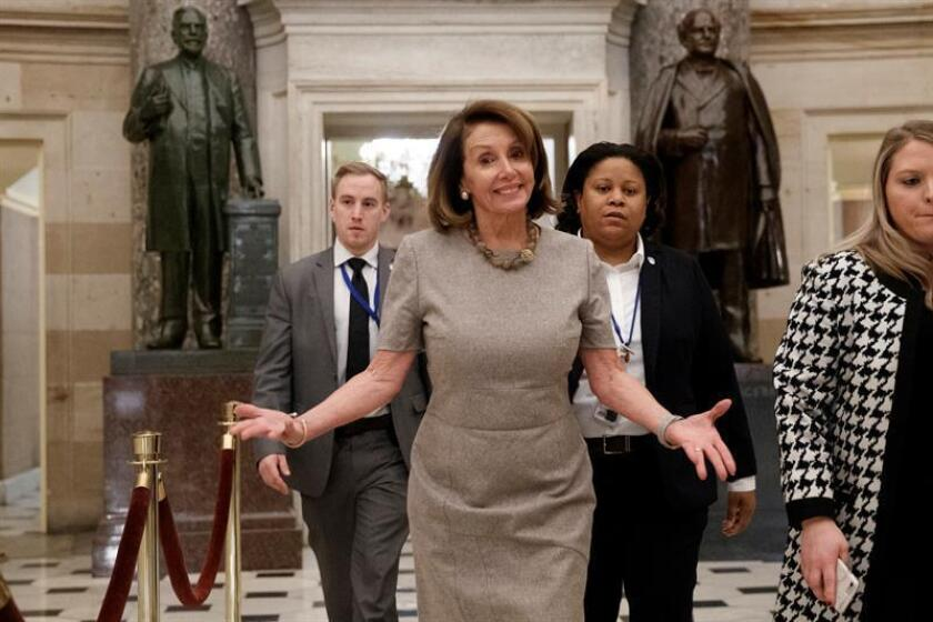 Speaker of the House Nancy Pelosi walks to the House Floor to vote on a continuing resolution to temporarily reopen the government in the US Capitol Capitol in Washington, DC, USA, 25 January 2019. President Trump in a Rose Garden statement announced a plan to reopen the government for a limited time while negotiations on border security take place. EPA-EFE/SHAWN THEW