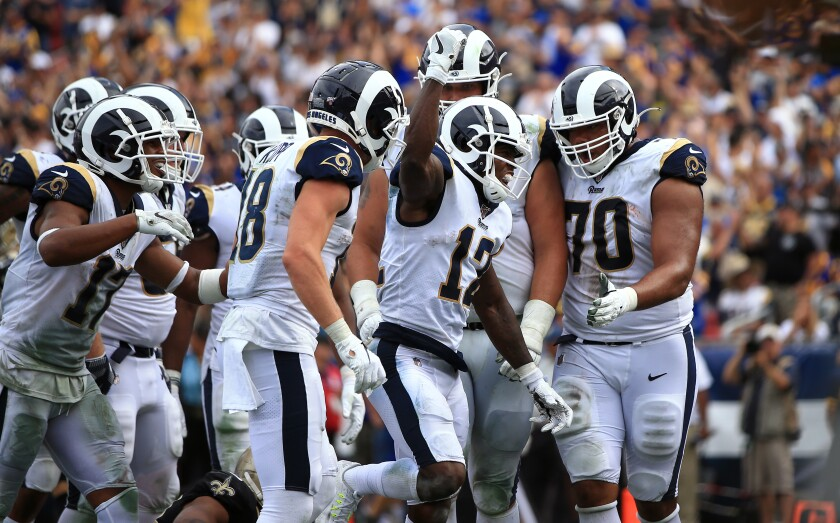 Rams wide receiver Brandin Cooks celebrates with teammates after scoring a touchdown.