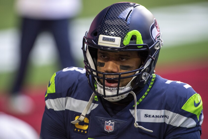 Seattle Seahawks quarterback Russell Wilson warms up before a game