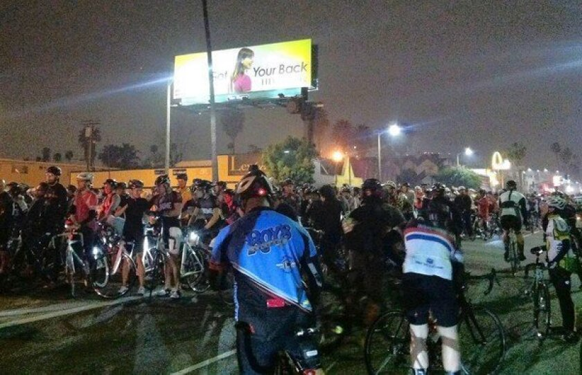 Thousands of cyclists gather at the corner of Sunset Boulevard and Fountain Avenue in Silver Lake, readying themselves for their own big race before the L.A. Marathon. The crash race is the largest urban-underground bike race in the world, and takes advantage of the road closures in the hours before the marathon.