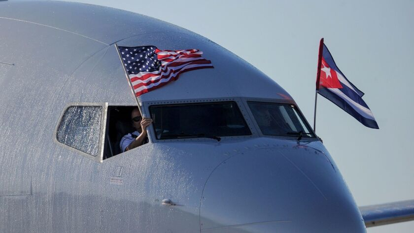 An American Airlines jet with U.S. and Cuba flags arrives in Havana.