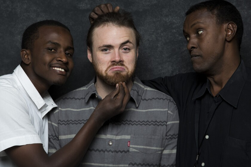 "Cutter Hodierne, center, with Abdikani Muktar, left, and Abubakr Mire of the ""Fishing"" cast, at Sundance festival in January."