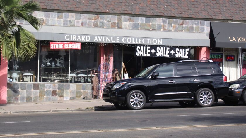 Signage is up announcing Girard Avenue Collection's upcoming closure.
