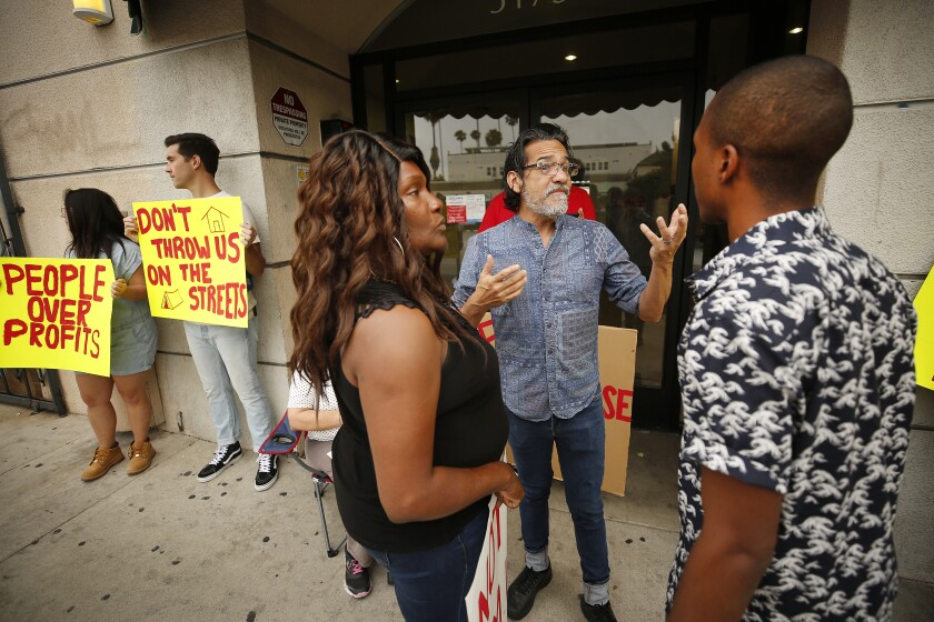 Activists and residents discuss concerns in July 2019 about a rent increase of more than 20% at the Kingswood Apartments in East Hollywood.
