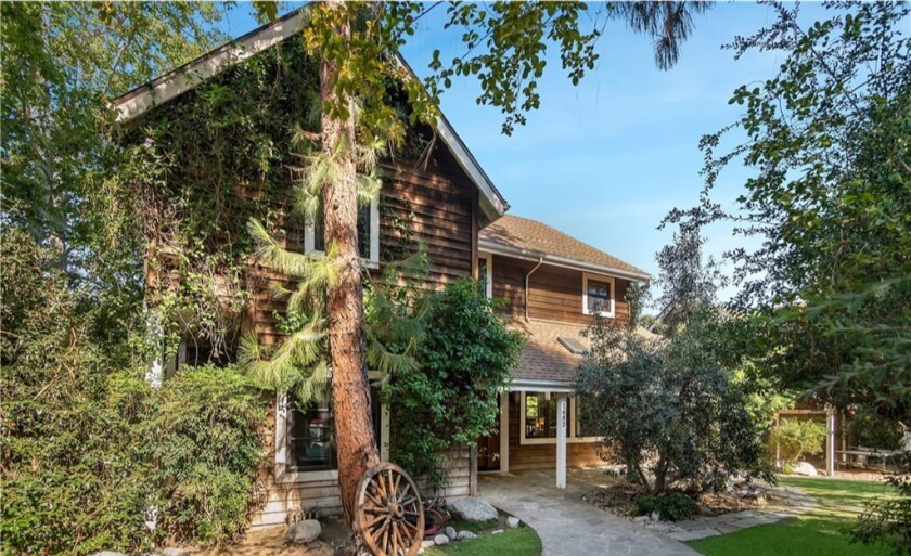 The half-acre compound holds a two-story home, writer's studio and equestrian facilities.