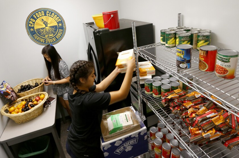 "UCLA student volunteers stock the shelves at UCLA's ""food closet,"" in the Student Activities Center on campus."