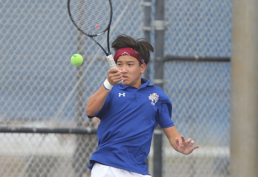 Fountain Valley High School's Alan Ton, shown running down a forehand in March 2020.