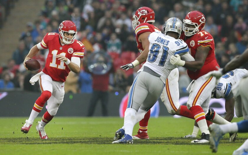 Kansas City Chiefs quarterback Alex Smith (11), left, runs with the ball during the NFL football game between Detroit Lions and Kansas City Chiefs Wembley Stadium in London,  Sunday, Nov. 1, 2015. (AP Photo/Tim Ireland)