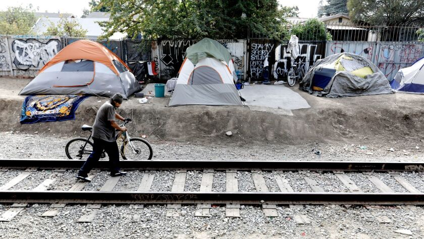 Raul Rodriguez lives at a homeless camp along West 117th and South Figueroa streets in Los Angeles. Health officials have been directed to install public toilets and hand washing stations in four homeless encampments throughout L.A. County to combat the hepatitis A outbreak.
