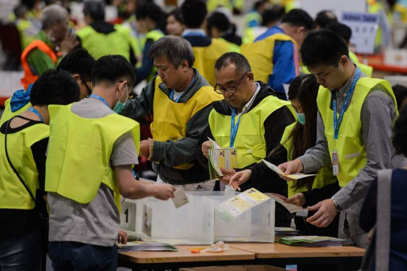 Electoral officials count votes that were cast for the Legislative Council election at the central counting station in Hong Kong on Sept. 5.
