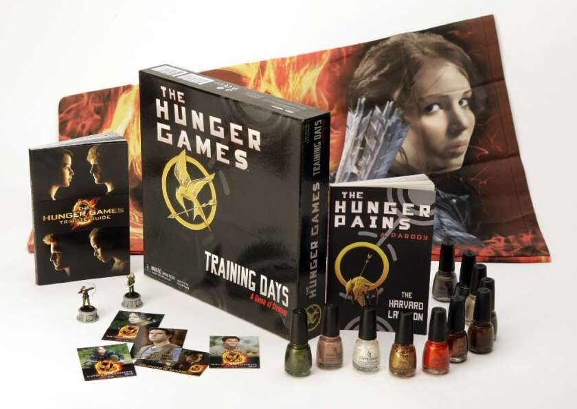 """There has been a vast variety of marketing tie-ins with the """"Hunger Games"""" movie franchise, including a Covergirl makeup line called the Capitol Collection."""