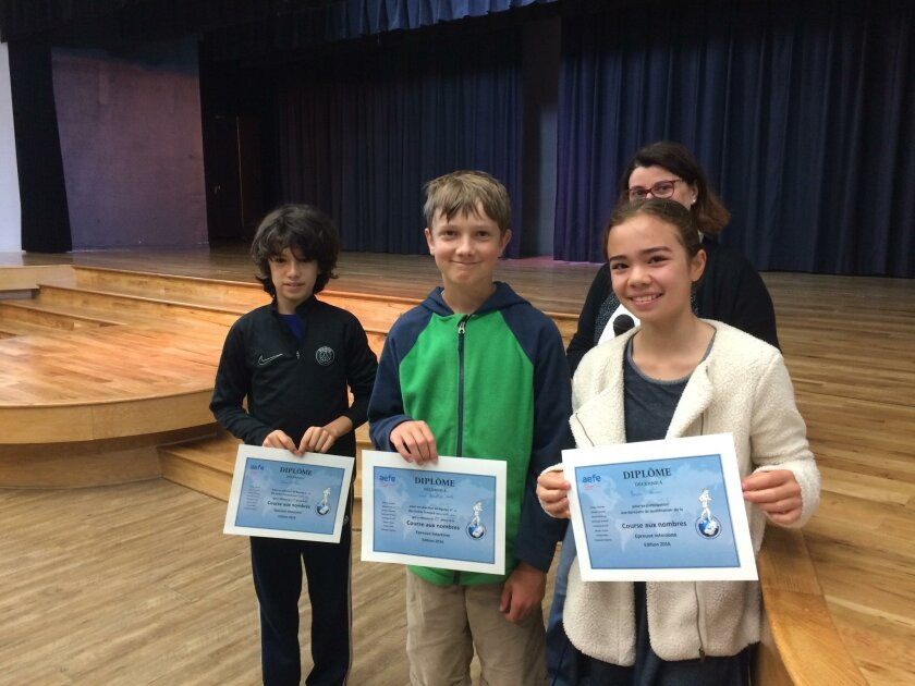 Alexander Price, David Llewellyn Smith and Emma Berman of the San Diego French-American School with their awards