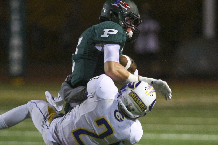 Poway's Jared Adelman (shown in an earlier game) scored on runs of 11, 5 and 27 yards to help the Titans defeat Westview on Friday.