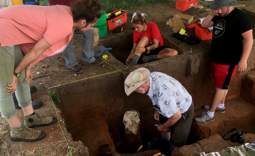 Professor Donald Blakeslee in one of the pits being excavated in Arkansas City. Joan Bayles watched