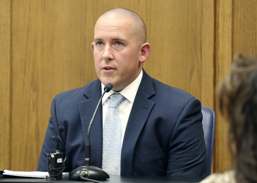 FILE - In this May 22, 2018 file photo, Wichita Police officer Justin Rapp describes the night he shot Andrew Finch on his front porch during a preliminary hearing in Wichita, Kan. Civil rights attorneys representing the family of Finch killed by police responding to a hoax emergency call are using the case to try to hold the city of Wichita accountable for what they call a troubled history of police shootings according to a brief filed Friday, Dec. 4, 2020, at the 10th Circuit Court of Appeals. (Bo Rader/The Wichita Eagle via AP, File)