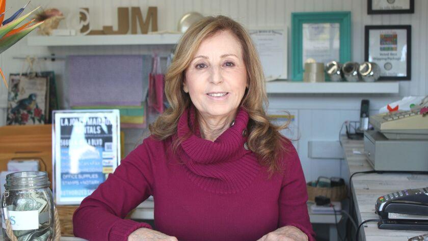 Anita Woods greets customers with a smile at La Jolla Mailbox Rentals, 5666 La Jolla Blvd.