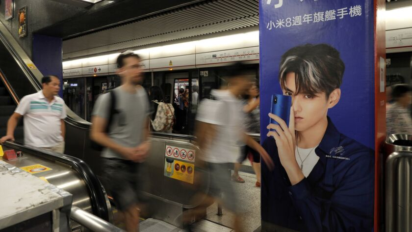 An advertisement for Xiaomi is displayed at a subway station in Hong Kong Monday, July 9, 2018. Xiao