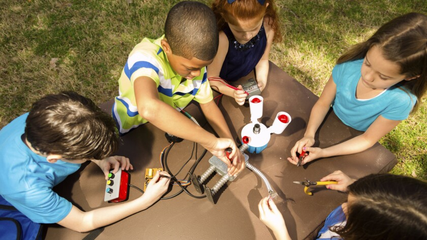 Children building a robot