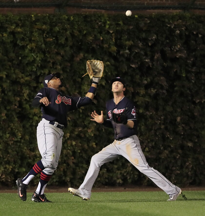 Indians left fielder Rajai Davis, left, and center fielder Tyler Naquin nearly collide as Davis catches a fly ball in the bottom of the fifth inning of World Series Game 4 on Oct. 29.