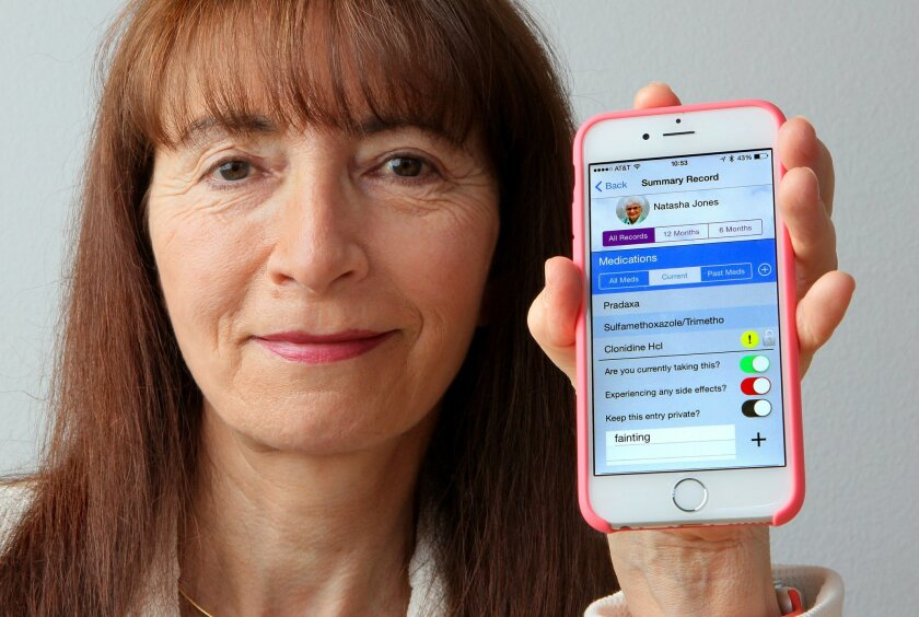 Humetrix Chief Executive Bettina Experton with the Del Mar company's iBlueButton app that lets Medicare beneficiaries and others manage their summary health records on mobile devices.