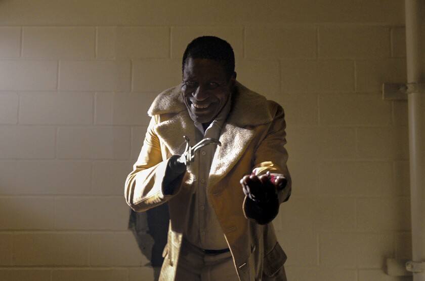 """A man with a prosthetic hand in the movie """"Candyman."""""""