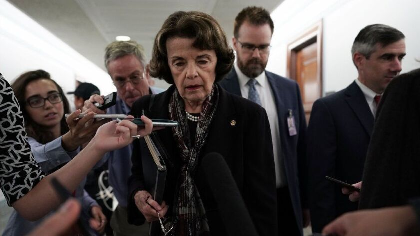 California Sen. Dianne Feinstein, ranking Democrat of the Senate Judiciary Committee, leaves after the panel approved, along party lines, the nomination of Judge Brett Kavanaugh to the Supreme Court on Friday at the Dirksen Senate Office Building on Capitol Hill in Washington.