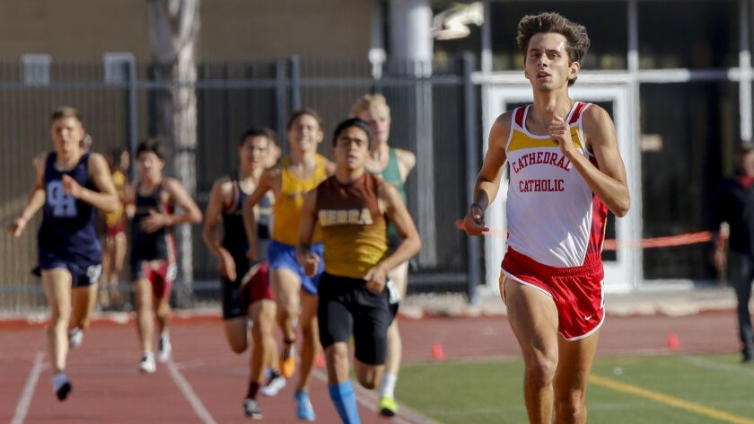 Cathedral Catholic's Joaquin Martinez de Pinillos makes his way to the finish line ahead of the pack