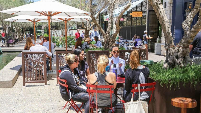 Patrons enjoy the recently added restaurant row area called The Pointe at the Westfield UTC Mall.