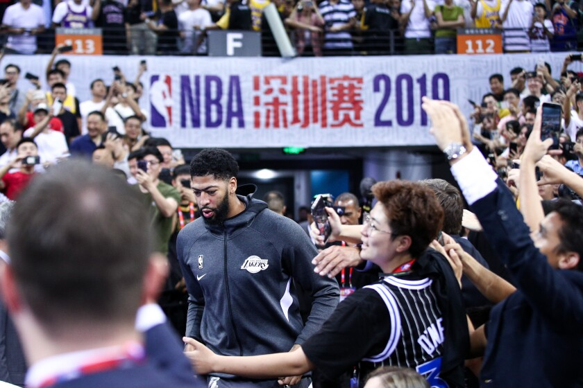 Lakers star Anthony Davis runs onto the court in Guangdong, China, on Oct. 12.