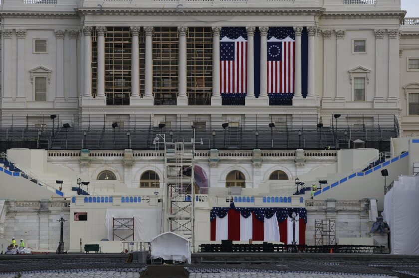 Employees prepare the U.S. Capitol for the inauguration of President-elect Donald Trump.