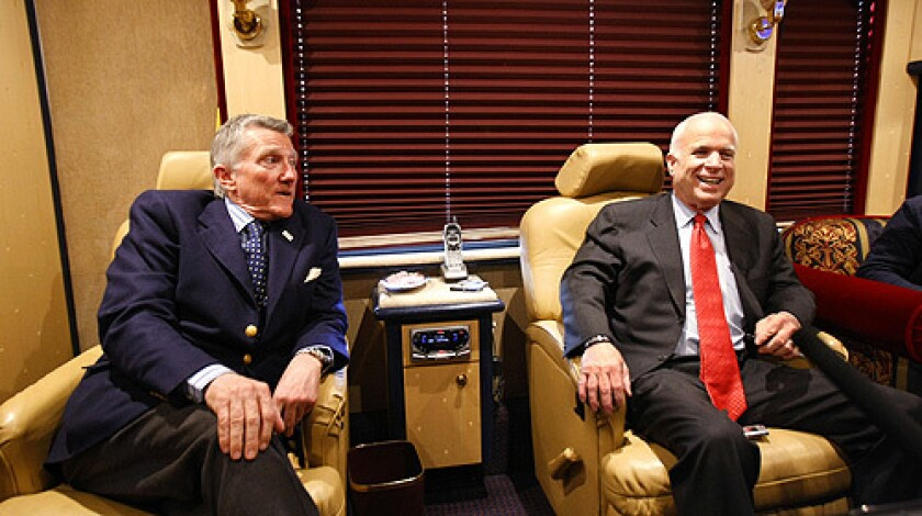 Republican presidential candidate, Sen. John McCain, right, and former Navy Secretary John Lehman speak on McCain's campaign bus, Friday, March 14, 2008, after a town hall meeting in Springfield, Pa.
