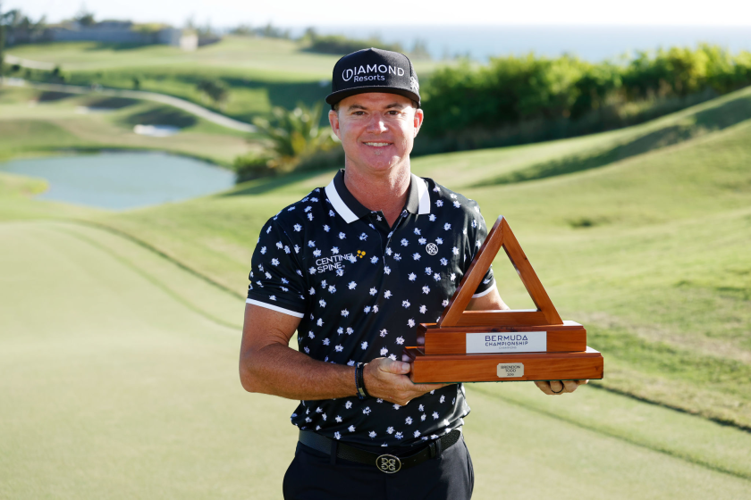 Brian Gay of the United States celebrates with the Bermuda Championship trophy after winning on Sunday.