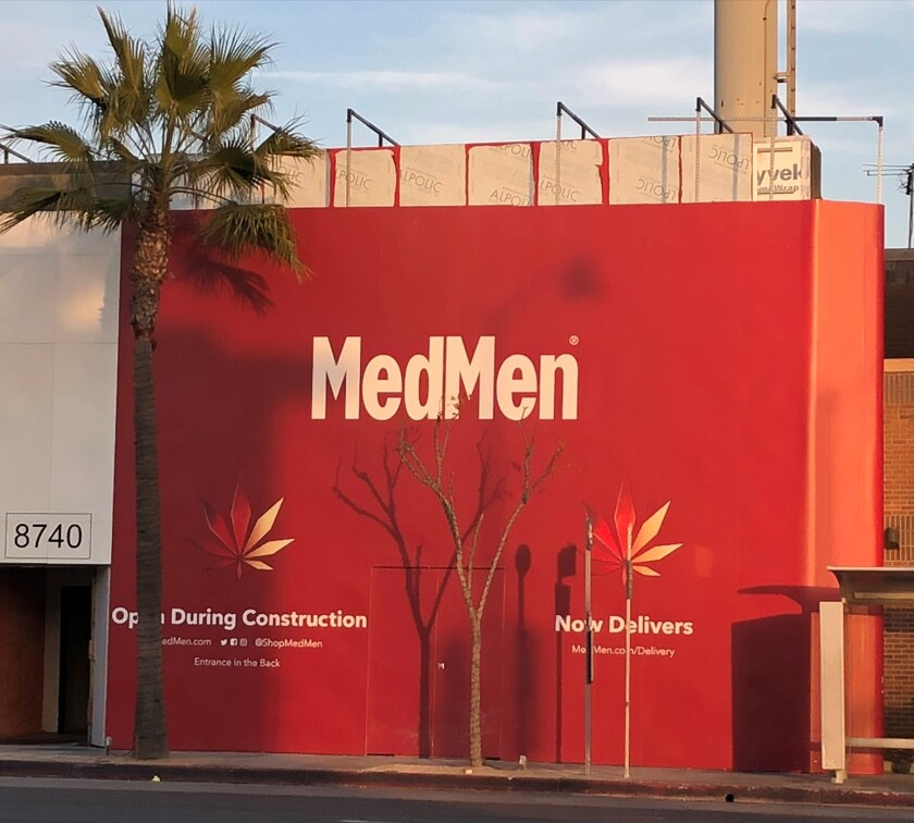 "A red wall that says ""MedMen"" at 8740 S. Sepulveda Blvd."